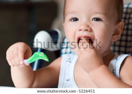 Baby eating - stock photo