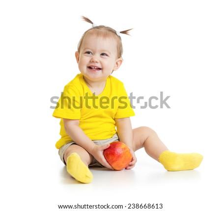 Baby eating apple sitting isolated - stock photo