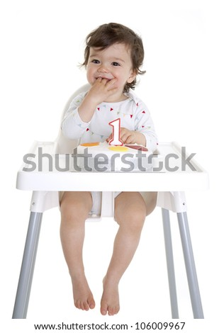 Baby eating birthday cake - stock photo