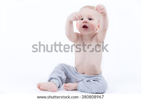 baby eating healthy crisps - stock photo