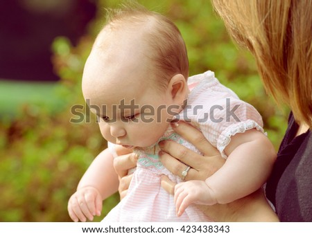 Baby exploring her surrounds - stock photo