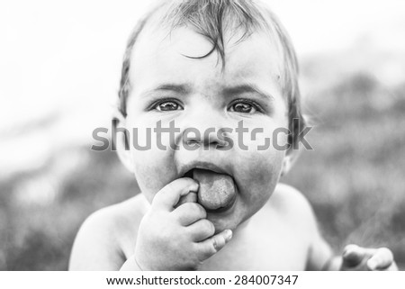 Baby face, black and white photo. - stock photo
