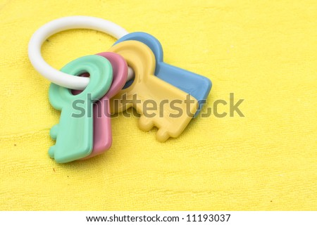 Baby facecloth with toy keys – baby items - stock photo