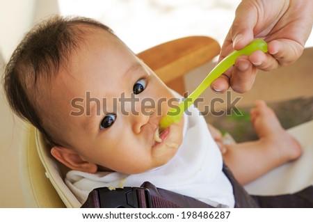 baby feeding - stock photo