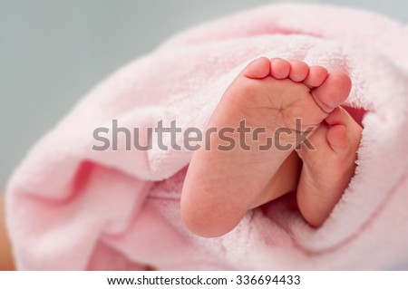 baby feet wrapped in a towel - stock photo