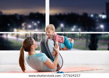 Baby fitness with mom - stock photo