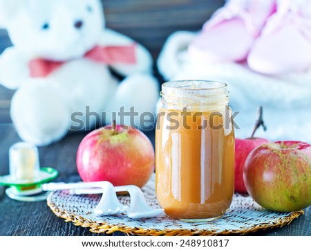 baby food in bank and on a table - stock photo