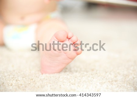 Baby foot on a carpet, close up - stock photo