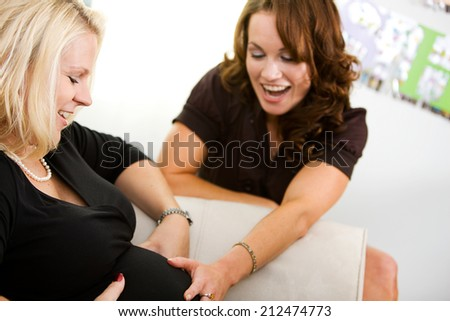 Baby: Friend Feeling Mother's Belly  - stock photo
