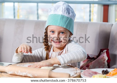 baby girl, a master class in cooking pizza , little chef in a restaurant - stock photo