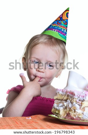 Baby girl and her birthday cake - stock photo