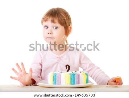 Baby girl and her birthday cake, studio - stock photo