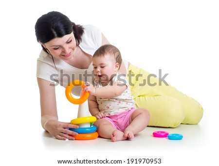 baby girl and mom playing together with toy - stock photo