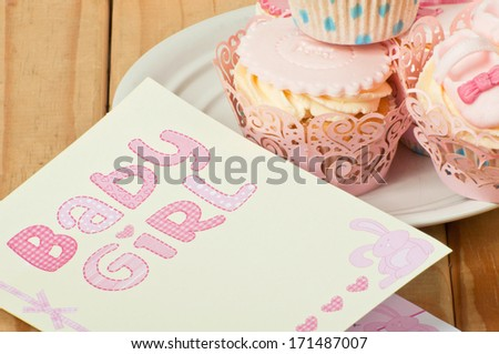 Baby girl card and cupcakes - stock photo