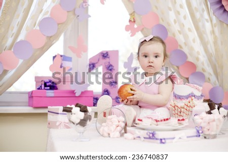 baby girl celebrating first birthday - stock photo