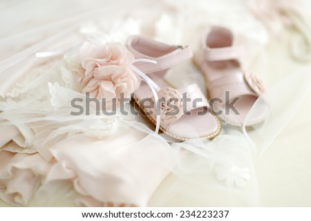 Baby girl christening shoes and flower headband - stock photo
