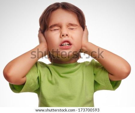 baby girl closed her eyes her ears loud noise fear isolated on white background gray large - stock photo