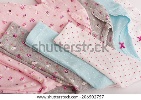 Baby girl colorful clothes. Set - stock photo