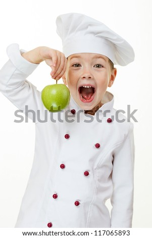 Baby girl cook with green apple - stock photo