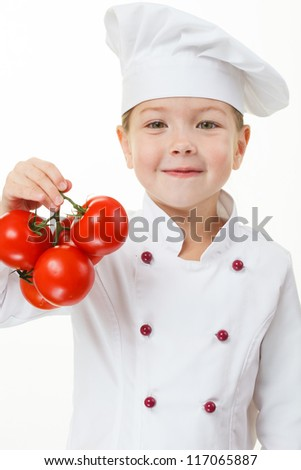 Baby girl cook with tomatoes - stock photo
