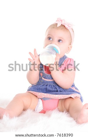 baby girl drinking milk - stock photo