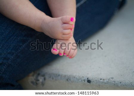 Baby girl feet with pink painted toenails.  - stock photo