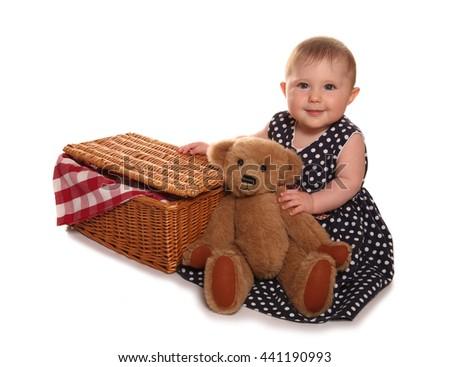 baby girl having a teddy bears picnic cutout - stock photo
