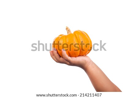 baby girl holding a ripe pumpkin on isolate - stock photo