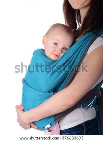 Baby girl in a carrier - stock photo