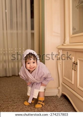 Baby girl in a plush bathrobe - stock photo
