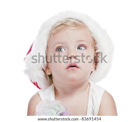 baby girl in a red new year cap - stock photo