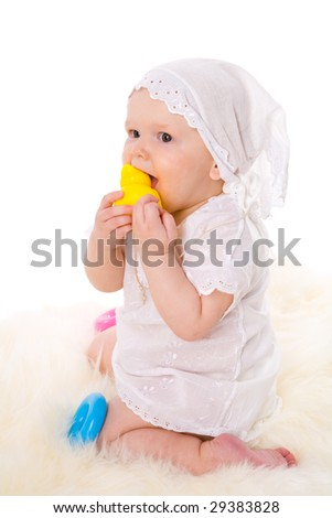Baby girl in age one year playing with toys isolated on white - stock photo