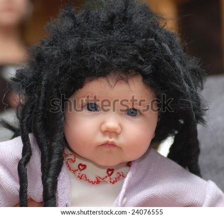 Baby girl in black wig - stock photo
