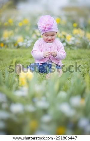 Baby girl in Dutch flower park - stock photo