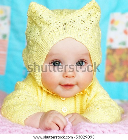 Baby Girl in Hooded Sweater - stock photo