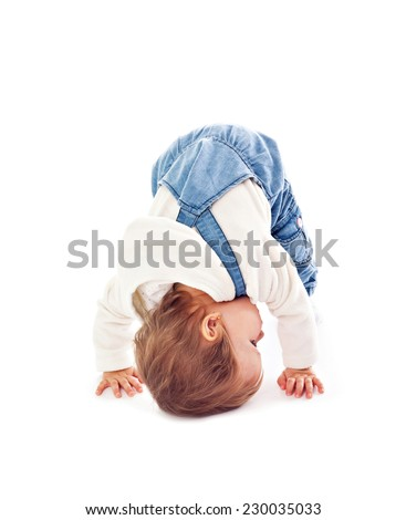 Baby girl in jeans on white - stock photo