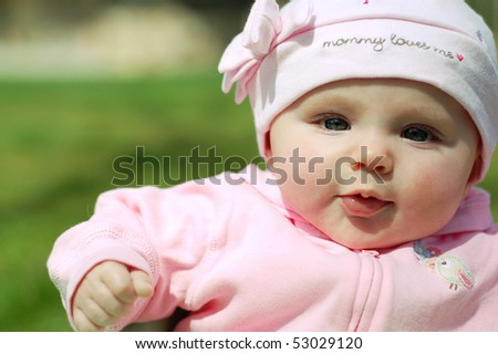 Baby Girl in Mommy Loves me Hat - stock photo