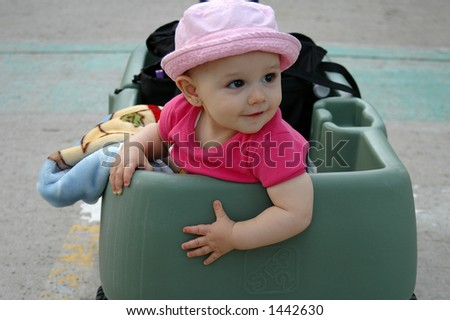 baby girl in wagon - stock photo