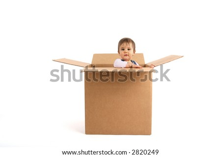 baby girl inside box, surprised - stock photo
