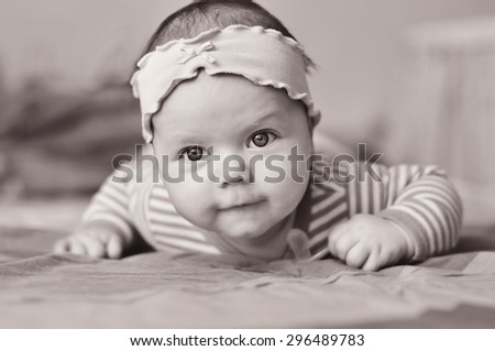 baby girl is keeping her head up - stock photo