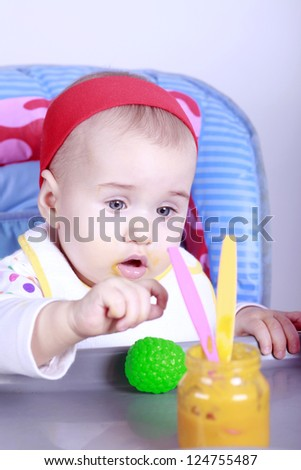 Baby girl learn to eat lunch - stock photo