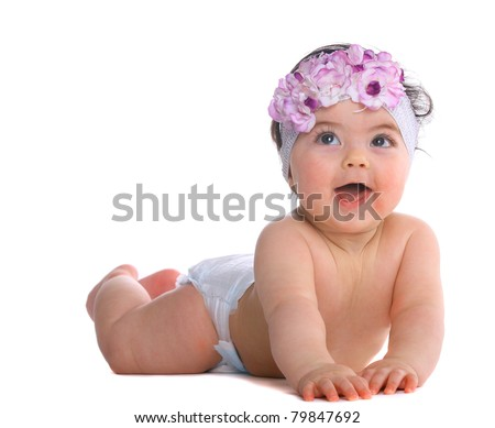Baby Girl looking above the camera isolated on whtie - stock photo