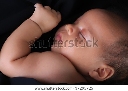 Baby girl, of African American and Caucasian heritage. - stock photo