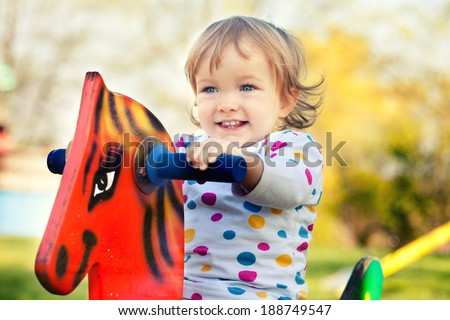 Baby girl on a playground - stock photo