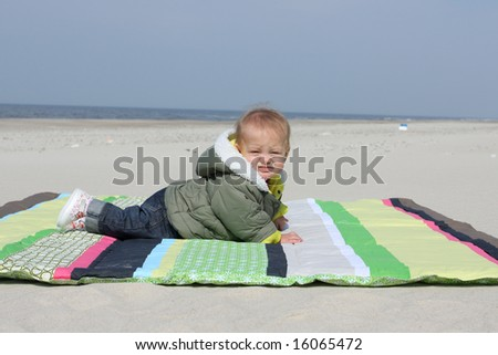 Baby girl on the beach - stock photo
