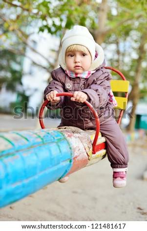 baby girl on the playground - stock photo
