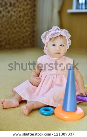 baby girl playing   toys at home - stock photo