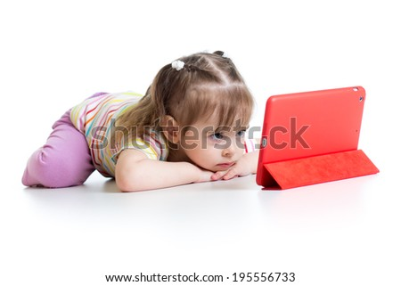 baby girl playing with a digital tablet - stock photo