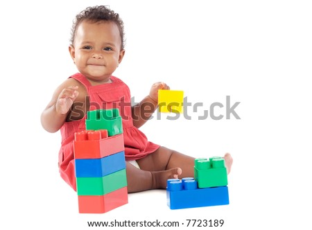 Baby girl playing with building blocks over white background - stock photo