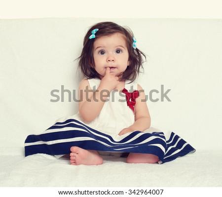 baby girl portrait, sit on white towel - stock photo